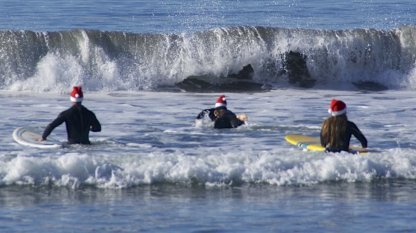 Santas go Surfing on Coronado Beach